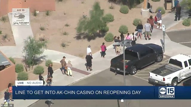 A line of people stretched to the parking lot at Arizona's Ak-Chin Hotel and Casino (pictured), which has been redesigned social distancing restrictions and sanitation safeguards
