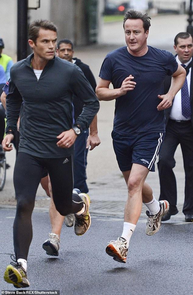 Personal trainer Matt Roberts and David Cameron take a morning run