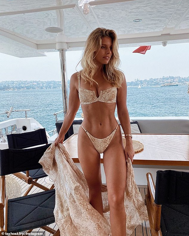 Bikini queen: The model is known for her incredible figure.Natasha told The Daily Telegraph earlier this year that she feels 'accomplished and energised' by squeezing in a workout even while on holidays, and is firm on never dieting