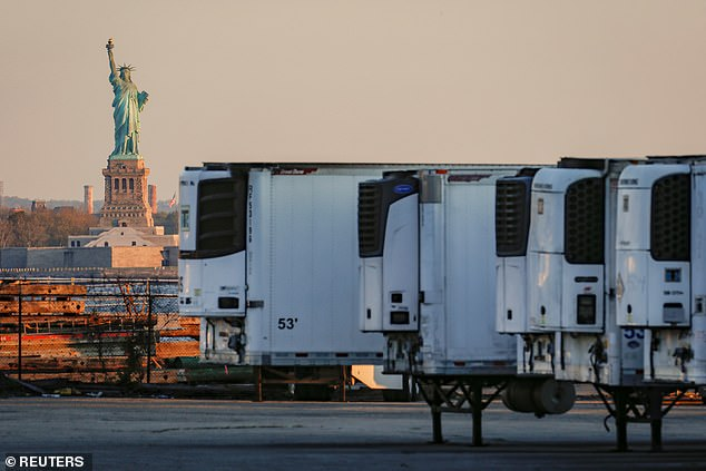 Refrigerated tractor trailers used to store bodies of deceased people are seen at a temporary morgue in Brooklyn