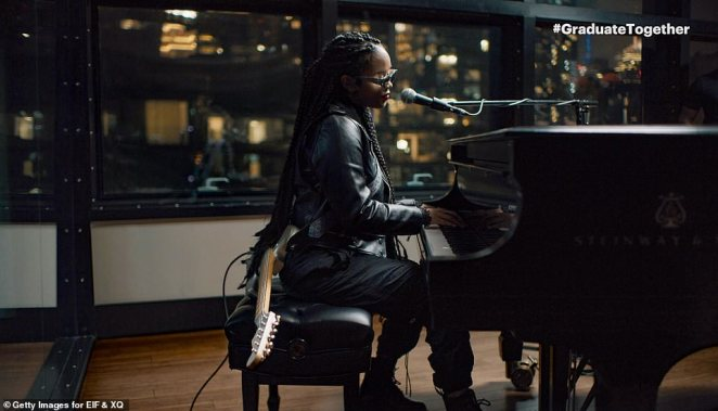 Beautiful view: She played piano against a beautiful cityscape out her window
