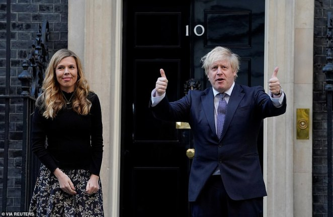 Asked whether nurses could expect a pay freeze as part of any recovery plan, Mr Johnson (seen with Carrie Symonds at the Clap for Carers on Thursday) said 'absolutely not'