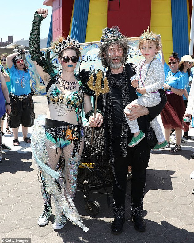 Pictured: Gaiman and Palmer with their son Anthony - known as Ash - during the Coney Island Mermaid Parade in New York