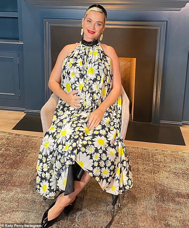 Blooming: In a series of self-portraits shared on Instagram before the long-awaited American Idol finale on Sunday, Katy Perry lovingly cradled her budding bump while wearing a dress printed with daisies