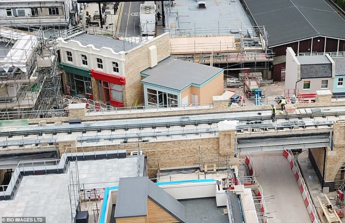 Under construction: builders were pictured getting to work on the new £ 87m EastEnders complex at London's Elstree studios last week