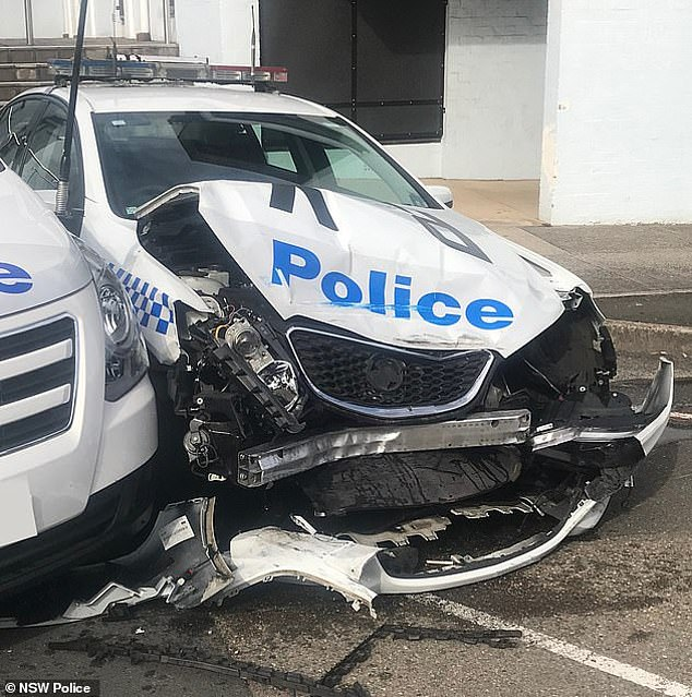 Smashed up: Tu's spectacular crash destroyed the front of a police sedan parked out the front of Eastwood Police Station, in Sydney's north-west