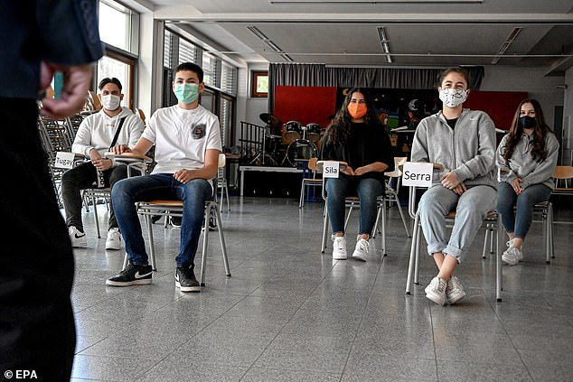 GERMANY: Pupils apply social distancing measures in class at Benzenberg secondary school in Duesseldorf, Germany, 19 May 2020