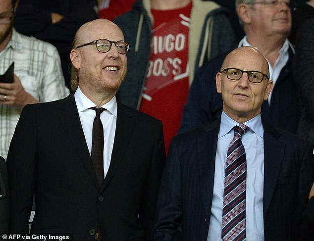 But the club's co-chairmen Avram Glazer (left) and Joel Glazer (right) have taken a very different approach with a under-performing agency Toppan Merrill