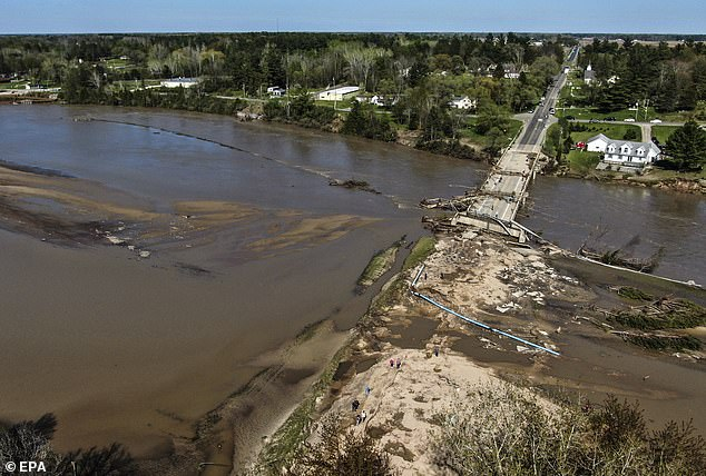 An aerial photo made with a drone shows damage to a road and bridge after the Edenville dam was breached near Edenville