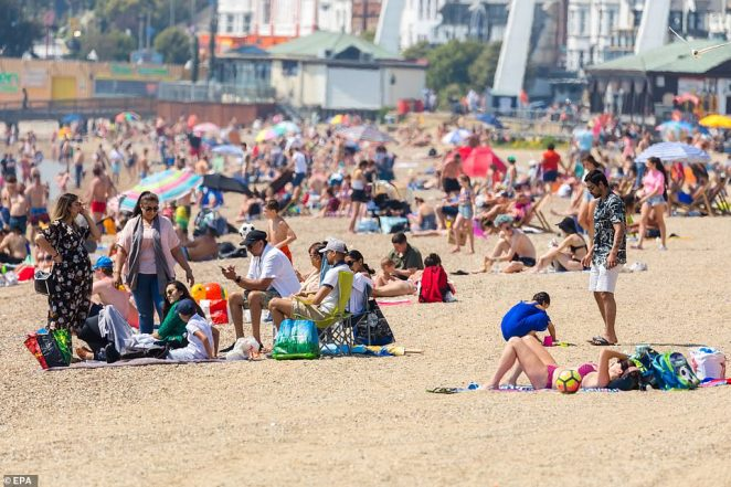 Beaches remained busy today, including Southend in Essex (pictured) where the number of people packing the sand made social distancing difficult