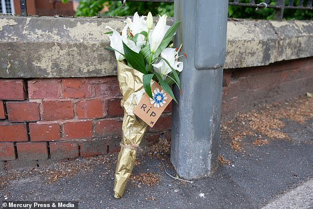 A tribute at the scene on Upholland Road in Wigan, Greater Manchester, on Thursday morning.Ms Belshaw's stepmother, Lisa Belshaw, said the victim would 'do anything' for her daughter