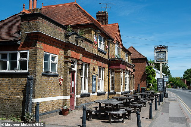 Empty tables outside the White Lion pub in Egham during the coronavirus lockdown as pubs remain temporarily closed