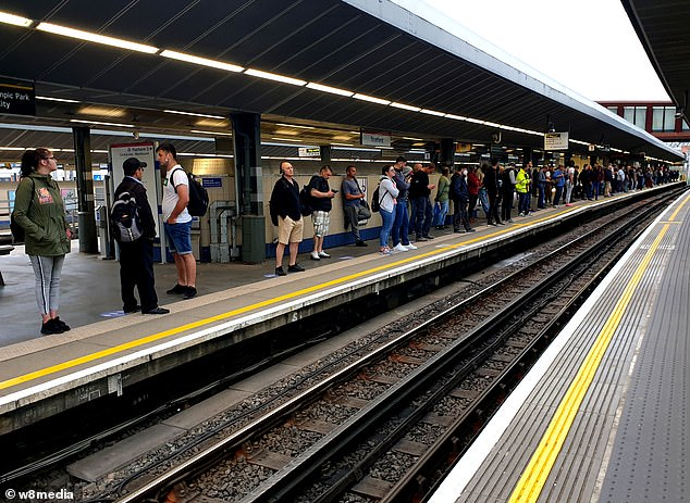 Commuters were seen waiting for a Central Line Tube service on their way back to work today