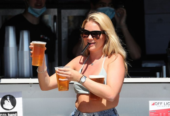 Sunseekers were seen in Brighton yesterday, the hottest day of the year so far, carrying take-away cups away from bars