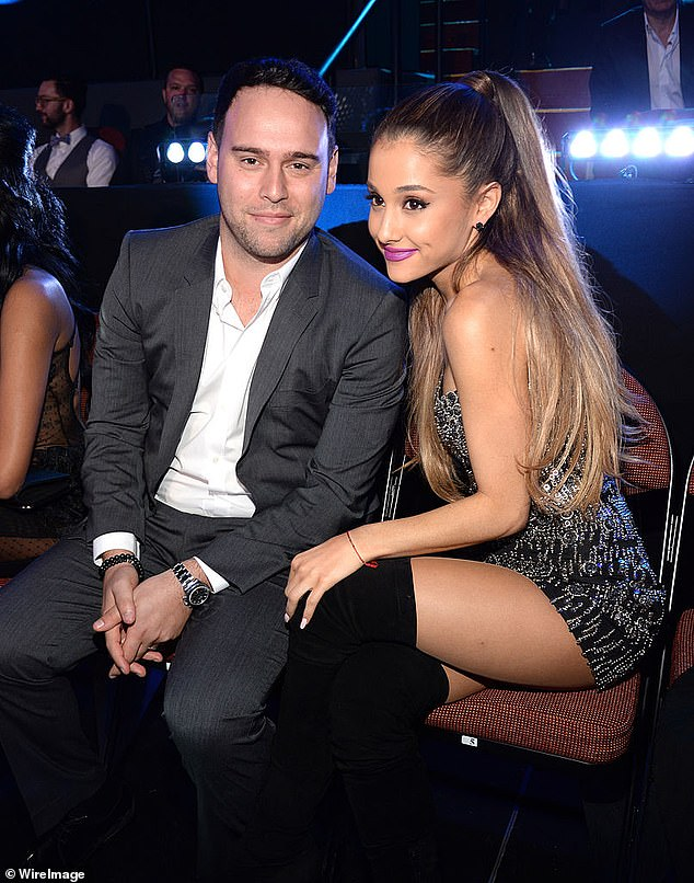Manager:Scooter, who along with Ariana visited the families and injured at the Royal Manchester Children's hospital in the days after the attack, said: 'She has PTSD, she's still suffering to this day' (pictured in 2014)