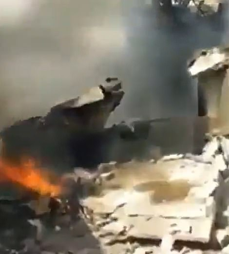 Photos of burning rubble were circulated online in the immediate aftermath of the crash