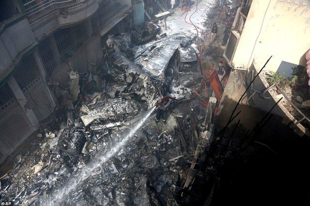 This was the scene of devastation as fire brigade staff used jet hoses to put out the fire. The plane crashed down as it approached Karachi's Jinnah International Airport