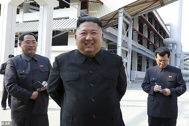 Pictured: Kim Jong Un supposedly makes his first public appearance after 20 days of absence that sparked rumours about his health, and suggestions that he had died as a result of a botched heart surgery