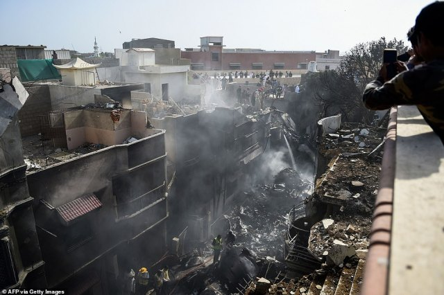 This was the scene as emergency crews rushed to the scene of the plane crash in the Model Colony in Karachi