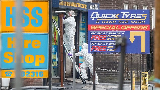Forensic police officers were pictured at the scene in Blackburn following the death of Ms Hachem