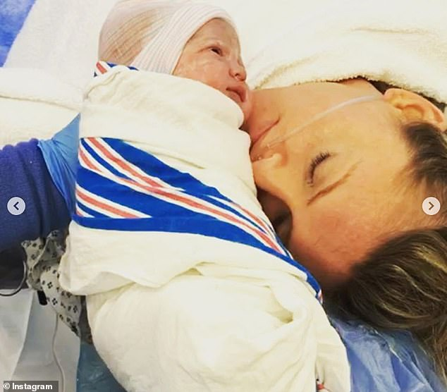 Mother and daughter: Jackie lovingly cradled her newborn daughter in the blink of an eye
