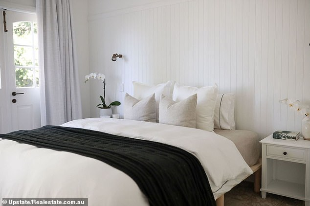 Dreamer! Master bedroom has crisp white interiors with built-in closet, chic bathroom and French doors that open to the deck