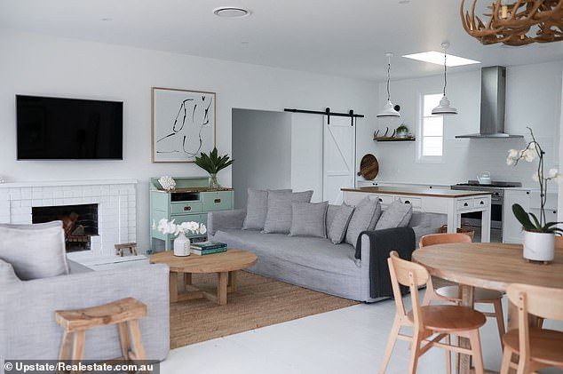 So elegant: the luxurious living room has a modern white interior, comfortable with the original fireplace of the house with conduits to the kitchen offering an open and inclusive family life