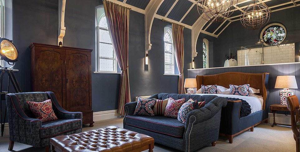 The plushest room at The Cookie Jar in Alnwick features a walk-in shower beneath a circular stained-glass window