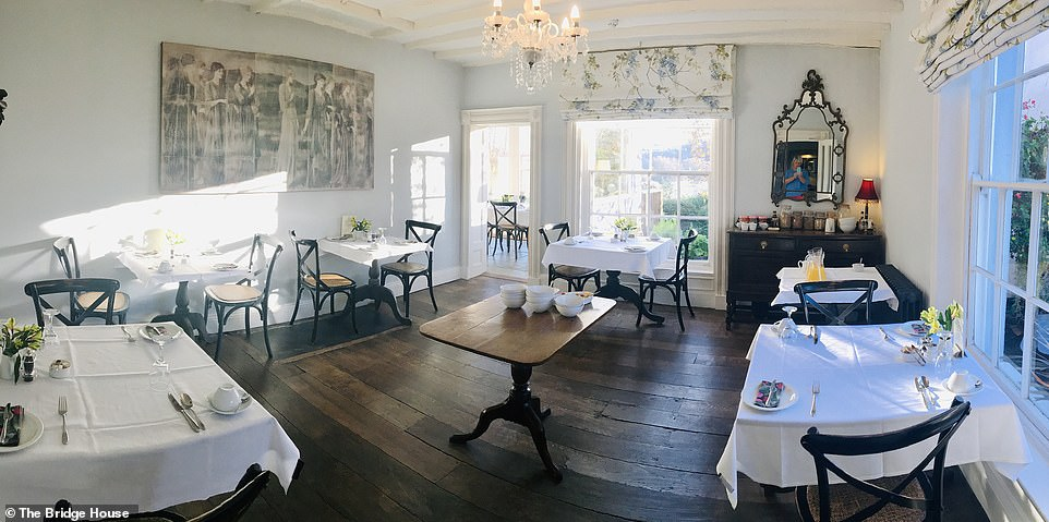 Vintage style: The Bridge House in Ross-on-Wye is a stylish getaway that feels like a private club. Pictured is the charming dining room