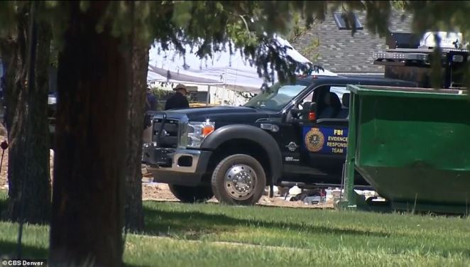 An evidence response team truck was stationed nearby as authorities searched the property
