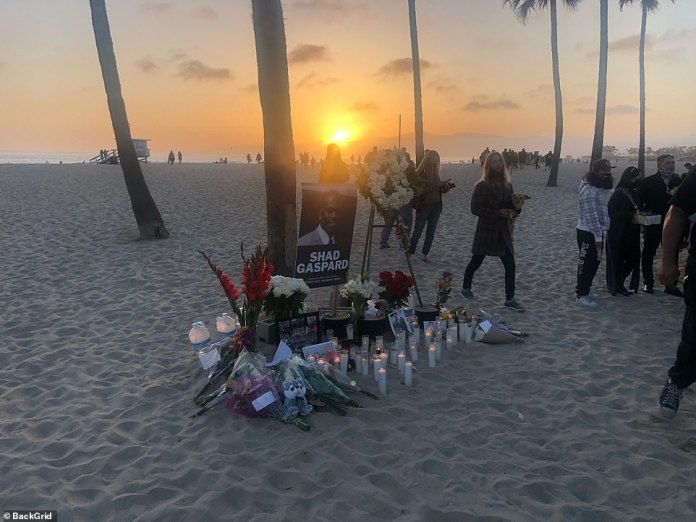 Friends, family, fans and loved ones gathered on the beach in LA where the hero father lost his life earlier this week, in images obtained exclusively by DailyMail.com