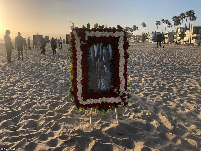 Fifteen photos were placed along the beach at Venice pier at the location halfway to the lifeguard station where his body was found