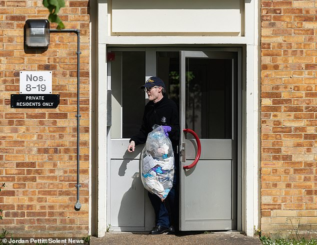 Police officers were seen carrying items out of a property in Leigh Park, Hampshire, after a body was found in nearby woodlands in the search for 16-year-old Louise Smith