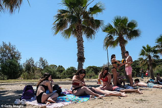 Sunbathers enjoy a day at Kavouri Beach, some 20km south of Athens, on Saturday