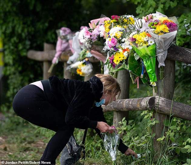 Mourners have placed flowers on the site where a body was discovered in Hampshire during the search for the missing 16-year-old Louise Smith.