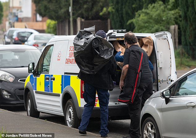 Officers investigating special forensic services were seen putting objects into a marked police van parked outside