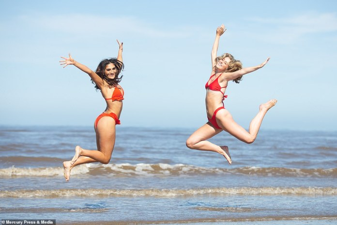 Amy Louise Thomas, 20, and Elli Wilson, 20, enjoying hot public holidays on Formby Beach in Merseyside this morning