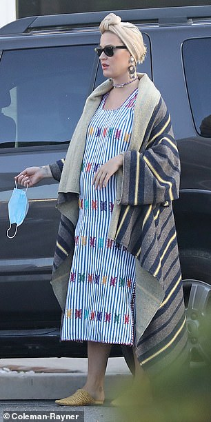 Elegant: she wore a beige turban over her blond locks, her sunglasses and a comfortable pair of woven sandals
