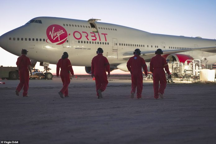 The crew heads for the plane on Monday. `` Cosmic Girl and our flight crew are safe and are returning to base, '' Virgin Orbit said in its official Twitter comment on the launch after its failed attempt.