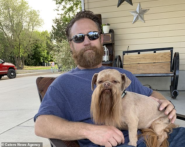 Like dog, like owner...but who has the best beard? Max, sitting on owner Cody's lap, is used to having his hair pampered all the time, say the family
