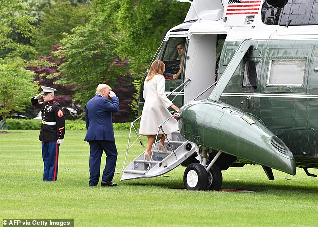 Melania Trump and President Trump board Marine One on the South Lawn of the White House Monday en route to Fort McHenry in Baltimore