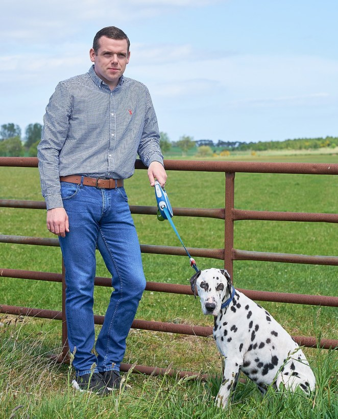MP Douglas Ross, MP for Moray, pictured today after he resigned from his post following the Dominic Cummings fiasco. This is him walking his Dog Murphy near his home address in Alves, Moray, Scotland