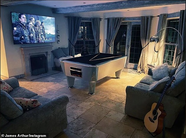 Cozy: In another sitting area, James has two other comfortable sofas which are located in front of a large pool table