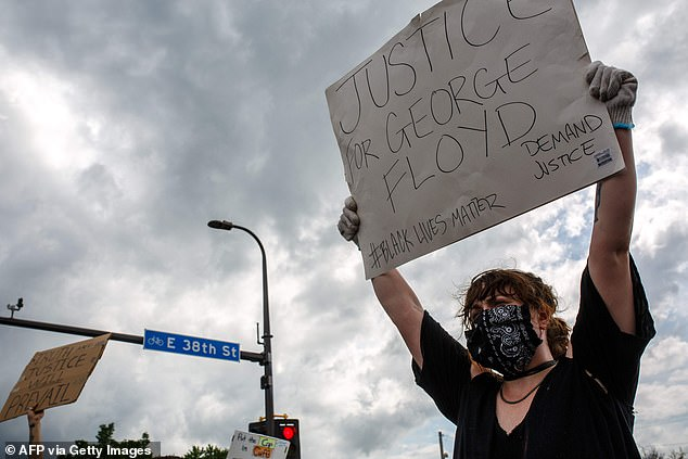 Indignation: Minneapolis protesters took to the streets after Floyd's death on Monday after an officer put his knee to his neck
