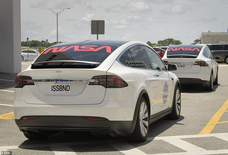 Hurley and Behnken depart for Launch Complex 39A in a convoy of Teslas during a dress rehearsal prior to the Demo-2 mission launch, at NASA's Kennedy Space Center in Florida, USA, 23 May 2020. The reg plate on the back reads: 'ISSBND', presumably an abbreviation of 'International Space Station bound'