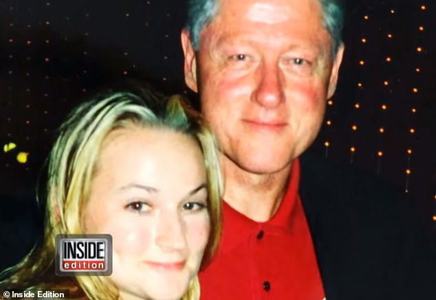 Photos appeared (above) in January of Clinton with her arm around Chauntae Davies, who recounted how she was recruited to be Epstein's personal masseuse and sex slave