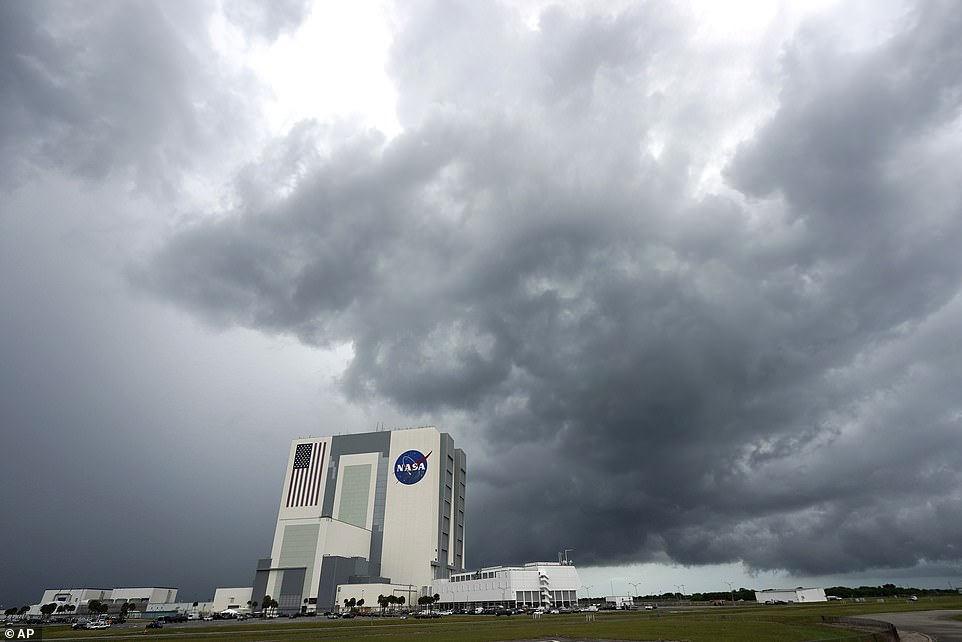 Storm clouds pass over the Vehicle Assembly Building at the Kennedy Space Center. Weather could potentially delay Wednesday's launch of the SpaceX Falcon 9 rocket and the Crew Dragon spacecraft