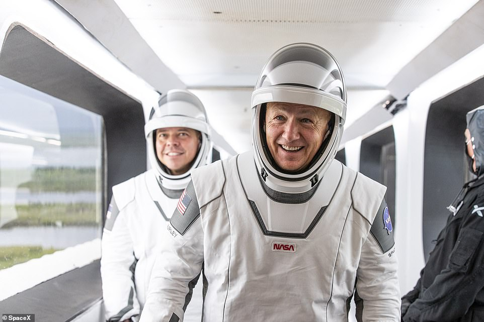 Bob Behnken and Doug Hurley board SpaceX's Dragon capsule for Wednesday's launch that will take them to the International Space Station