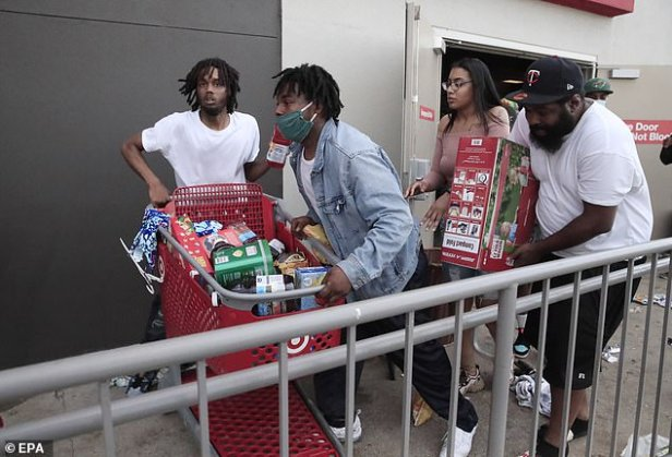 Looters steal goods from a Target store in Minneapolis in the midst of the second day of protests over George Floyd's death