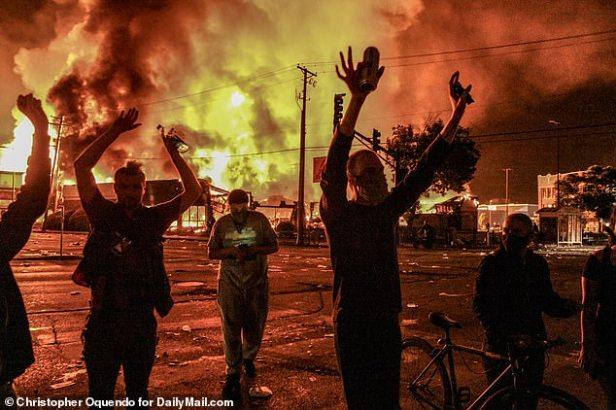 Floyd's killing in Minneapolis has provoked days of unrest in Minneapolis, cluminating in looting last night, pictured.